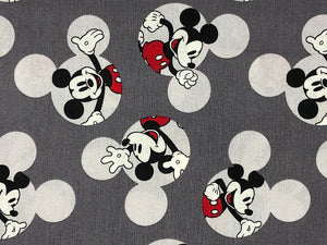 Close up of Mickey Mouse on Grey cotton Fabric