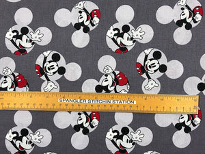 Ruler on Grey fabric to show sizing of Mickey Mouse.