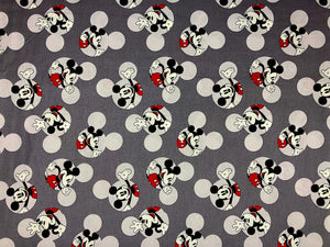 Grey cotton fabric covered with Mickey Mouse