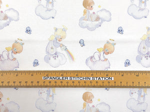 Ruler on fabric showing size of precious moments boys and girls.