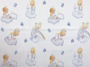 White cotton fabric covered with precious moments angels.