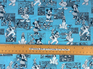 Ruler on fabric to show sizing of comics and Disney characters.