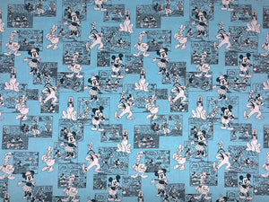 Blue fabric covered with Disney Comic Strips.