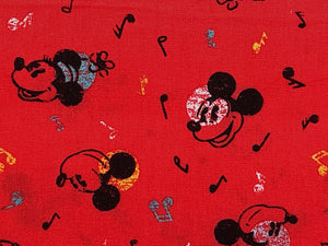Close up of Mickey Mouse and music notes.