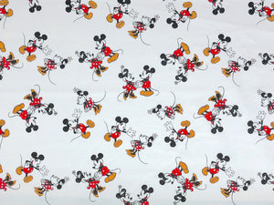 White cotton fabric covered with Mickey and Minnie Mouse