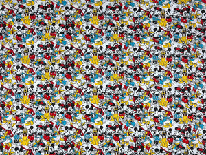 White cotton fabric covered with Mickey Mouse, Minnie Mouse, Donald Duck and Pluto