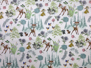 White cotton fabric covered with Bambi and Friends.