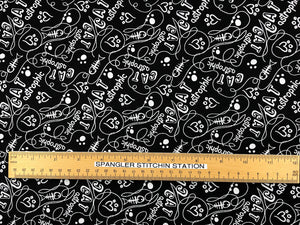 Ruler on fabric to show sizing of text.
