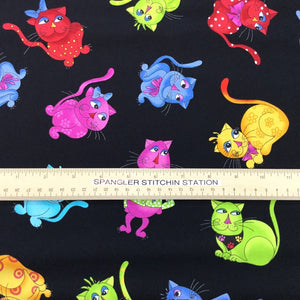 Ruler on fabric to show sizing of the cats.