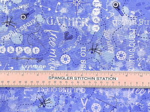 Ruler on fabric that is covered with sewing notions and sewing sayings.