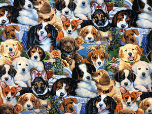 Fabric covered with puppies.