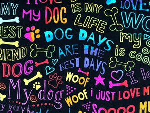 close up of black cotton fabric covered with dog saying such as dog days are the best days and more.