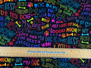 Ruler on black cotton fabric covered with dog sayings.