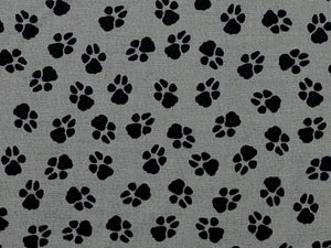 Close up of grey fabric covered with paw prints.