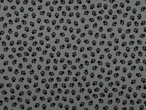Grey cotton fabric covered with paw prints.