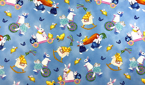 Blue cotton fabric covered with Bunnies, chicks, butterflies and more