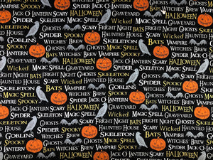 Black cotton Halloween fabric covered with pumpkins, bats, birds and spooky sayings.