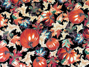 Close up of black cotton fabric covered with pumpkins and leaves.