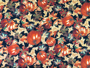 Black cotton fabric covered with pumpkins and leaves.