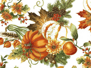 Close up of white cotton fabric that is covered with pumpkins, gourds, leaves and pinecones.