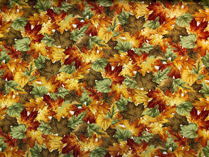 Cotton fabric covered with leaves in shades of orange, brown and green.