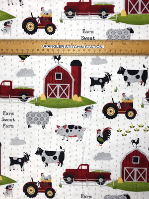 Ruler on fabric showing width of barn and animals.