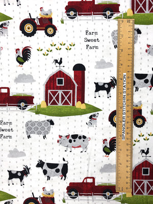 Ruler on fabric showing height of barn and animals.