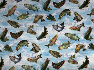 Cotton fabric covered with fish jumping out of the water.