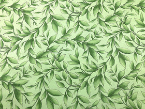 Light green cotton fabric covered with green leaves