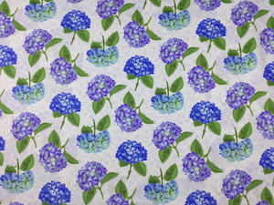 Cotton fabric covered with pretty blue and lavender hydrangeas.