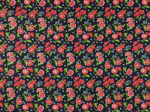 Black cotton fabric covered with red poppies and green leaves.