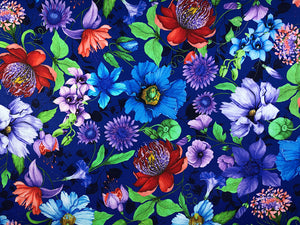 Blue fabric covered with clematis, fuchsia and other flowers.