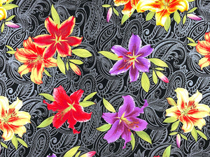 Close up of black fabric covered with lilies.
