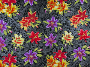 Black fabric covered with purple, yellow and red lilies.
