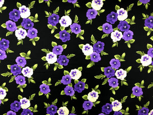 Black cotton fabric covered with purple and yellow pansies
