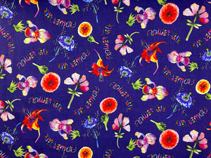 Dark purple cotton fabric covered with iris, lilies and other flowers.