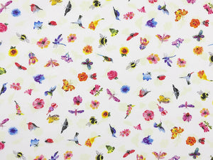 White cotton fabric covered with small dragonflies, hummingbirds, bees, birds, and flowers.