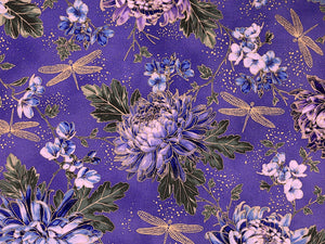 Lavender cotton fabric covered with dragonflies and hydrangeas.