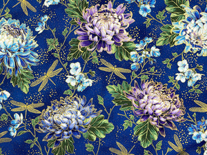 Blue cotton fabric covered with gold dragonflies and purple and blue hydrangeas.