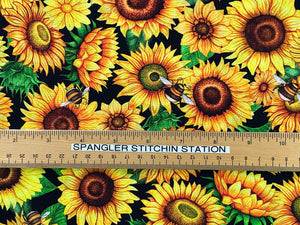 Ruler on fabric to show sizing of sunflowers and bees.