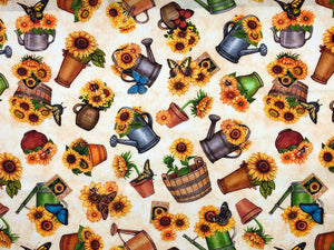 Cream cotton fabric  covered with sunflowers in watering cans and flower pots.