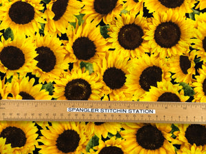 Ruler on fabric to show how big the sunflowers are.