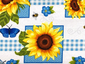Close up of a blue butterfly and yellow sunflower.