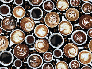 Black fabric covered with cups filled with coffee.