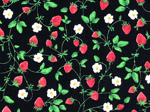 Close up of strawberries, leaves and flowers.