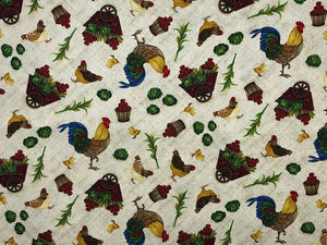 Light beige/tan fabric covered with roosters, apples, lettuce and corn stalks.