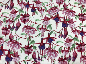 Cotton fabric covered with fuchsias.