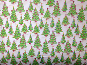 Christmas trees covered with candy cover this fabric.