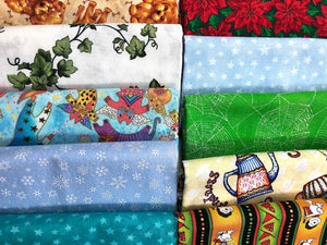 Assorted Half Yard pieces of fabric.