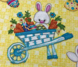 Close up of Easter Bunny with Easter Cart full of Eggs and carrots
